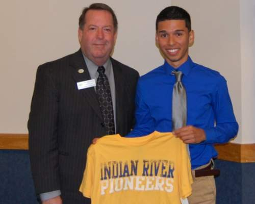 Holding up Indian River Pioneers shirt